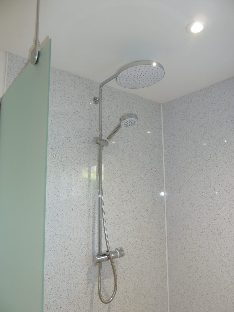one of the double showers in the wet room