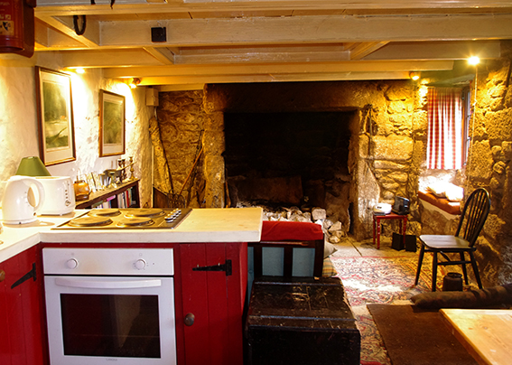 Kitchen and living space with large fire